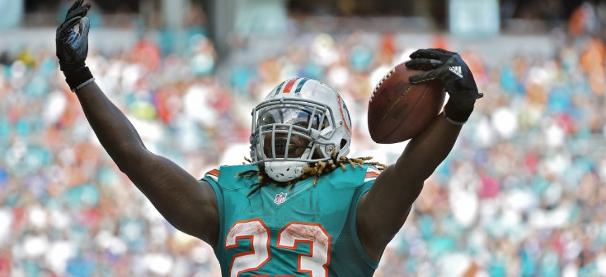 Oct 23, 2016; Miami Gardens, FL, USA; Miami Dolphins running back Jay Ajayi (23) celebrates after scoring a touchdown against the Buffalo Bills during the second half at Hard Rock Stadium. The Miami Dolphins defeat the Buffalo Bills 28-25. Mandatory Credit: Jasen Vinlove-USA TODAY Sports