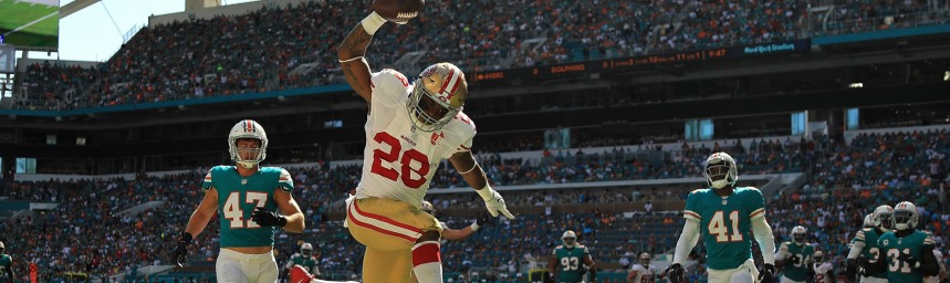 MIAMI GARDENS, FL - NOVEMBER 27:  Carlos Hyde #28 of the San Francisco 49ers scores a touchdown during a game against the Miami Dolphins on November 27, 2016 in Miami Gardens, Florida.  (Photo by Mike Ehrmann/Getty Images)