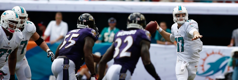 Oct 6, 2013; Miami Gardens, FL, USA;  Miami Dolphins quarterback Ryan Tannehill (17) passes the ball in the second quarter of a game against the Baltimore Ravens at Sun Life Stadium. Mandatory Credit: Robert Mayer-USA TODAY Sports